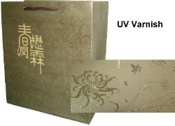 UV varnish- phun uv tui giay-